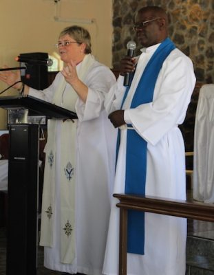 Bishop Sarah Macneil preaches with a translator at her side at St. Mary Magdalene Anglican Church in Lusaka, Zambia on April 17.